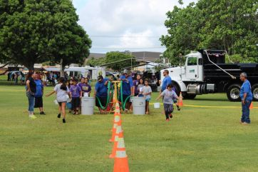 "In ""The Long Haul"" activity at Kauai's Make a Splash festival, Sept. 24, students competed in a water-hauling game to better appreciate today's readily available water supplies. Students learned how easy access to water can cause people to use more than what's necessary."