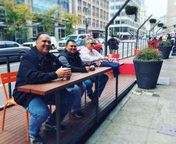 Kaua'i Mayor Bernard Carvalho, Jr. , Kaua'i County Planning Director Michael Dahilig and Kaua'i County Engineer Larry Dill enjoy a city parklet in Seattle. The county officials were in Seattle last week for the Pacific Northwest Peer Exchange Tour.