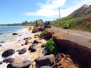 Road crews attempt to save 'Aliomanu Road, 2008. Photo by Jim O'Connell