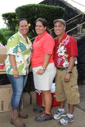 Left to right, volunteers Mahe Vegas, Maile Poai and Mika Doctolero