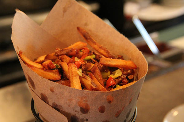 Diavola fries: French fries with pickled peppers and served with a sriracha aioli and sea salt. Hot and spicy!