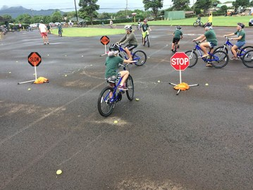Kapa'a Elementary School fifth-grade students attending the Safe Routes to School Traffic Safety Program worked their way up to riding predictably through an intersection using signaling and lane positioning.