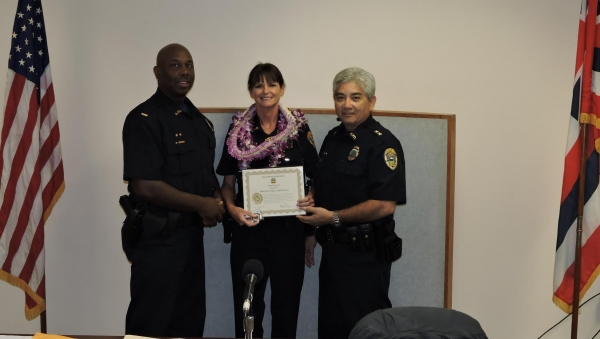 L-R: Lt. Rod Green; Officer of the Month Sgt. Darla Abbatiello; and Assistant Chief Roy Asher.