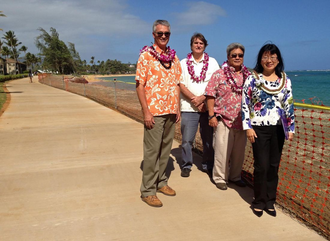 County Engineer Larry Dill, Doug Haigh, Building Division Chief, Lyle Tabata, Deputy County Engineer and Nadine Nakamura, Managing Director, are pleased with the completion of the Pono Kai seawall repair project.