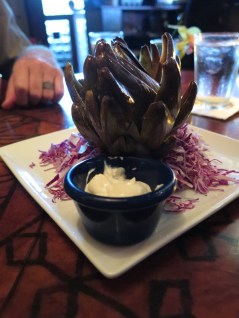 This artichoke is marinated and then steamed so all the spices come out. Then you get the visceral experience of tearing it apart layer from layer in flavorful dipping sauces. This was my best artichoke experience by far.