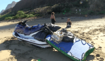 A jet-ski taken as evidence by DLNR officers is seen here. The alleged jet-ski operator, Francis Kinimaka, is standing on the background. DLNR video grab.