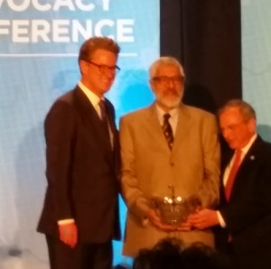 "Dr. Bal receives the AMA Nathan Davis Award from emcee ""Morning Joe"" Scarborough, former Florida Congressman and Chair of the AMA Board of Trustees, Dr. Stephen Permut. Photo courtesy UH"