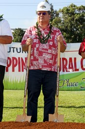 State Sen. Ron Kouchi, double fisted with shovels.