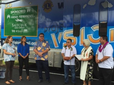 Blessing: Annie Valentin, Lori Naone (Kaiser), Sen. Kouchi, former Lions district governor Roy Nishida, Kahu Nahi Hill and Lions district governor Kelvin Moniz at vision bus blessing.