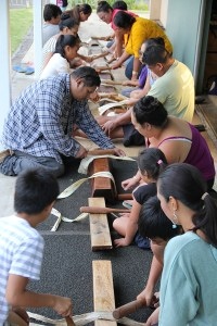 Families beating kapa together at a workshop last month in Lihu'e.