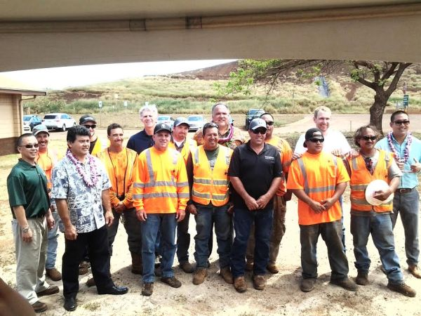The crew from the Kekaha Landfill also attended Tuesday's blessing. Pictured L-R: Mark Kawakami; Evan Vasconcelles; Troy Tanigawa; Spencer Link; Pohaku Stone; Todd Svetin; Chris Tavares; Mike Minkemann; Larry Yadao; Mayor Carvalho; Chad Pimental; Keola Cruz; Brandon Malama; Matt Heahlke; Kimo Palama; Rep. Derek Kawakami