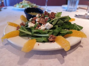 Arugula Salad. It's good roughage. Island grown spicy arugula plus sweet candied nuts plus smooth cool goat cheese plus tangy citrus dressing equals all the stuff I want in a salad.