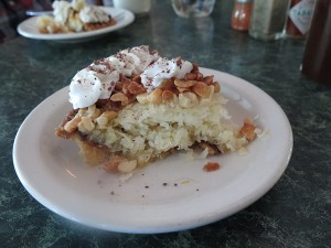 Kōkeʻe Lodge has two pies on the menu, and I recommend trying both, the coconut and the liliko'i chiffon. Pictured here is the coconut pie, made from real coconut. It's got a lining of chocolate and chopped mac nuts on top. It tastes a little like an almond joy, but better because it's fresh PIE!