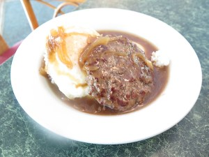 Kōkeʻe Lodge serves breakfast all day, including a loco moco made with local grass-fed Makaweli beef. The house-made bone broth is thickened with corn starch rather than the usual flour so it's gluten free! The broth is not salted, but the patty is, so when put together, it works as a whole not-salty unit. Denise Koerte, staff at the Lodge, recommends a rare patty and an over-easy egg.