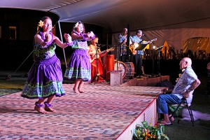 """Hula dancers at a luau at the Courtyard Marriott perform to the song """"Tutu Kale"""" in front of Uncle Charlie. His good friend Chucky Boy Chock composed the song in his honor."""