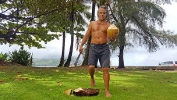 Native Hawaiian woodcarver Keoni Durant loves to share coconuts with locals and visitors. 'I realize my position in life, that I born for remind people they the same as me, that they born as love … We're all here as human beings to care for each other.' Photo by Léo Azambuja