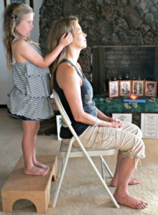 Shalandra Abbey's Kaua'i student Tessa Dawe Fernandez gives Reiki in 2012 at 7 years old in her First Degree Reiki Class.