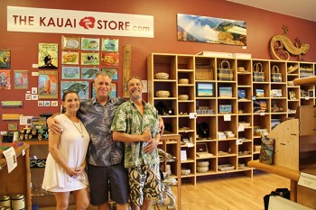 The Kaua'i Store owner Eric Burton, center, with artists and staff Mary Felcher and Chongolio.