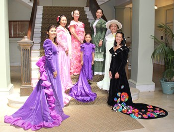 Kaua'i residents pose with their holokū at Historic County Building in Līhu'e. From left to right, Pua Rossi-Fukino, Polei Palmeira, Donna Stewart, Saebrie Pegeder, Barbara Green, Helen Wong Smith and Victoria Lam.