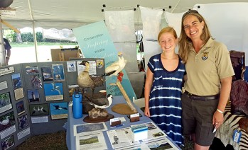 Halli Holmgren is seen here with Heather Abbey Tonneson, refuge manager for the Kaua'i National Wildlife Refuge Complex, during the Kaua'i Conservation Expo at McBryde Gardens, Lawa'i.