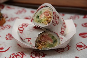The Japanese Sushi Burrito, made with shrimp tempura, crab meat, spicy tuna, cucumber, avocado and the Kenji sauce.
