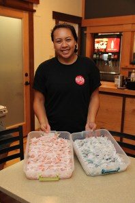 A staff at Kenji is seen here holding two trays of fresh mochi, made on Kaua'i.