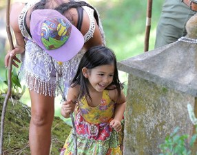 A child at the Pilgrimage of Compassion in 2017.Photo by Mike Teruya