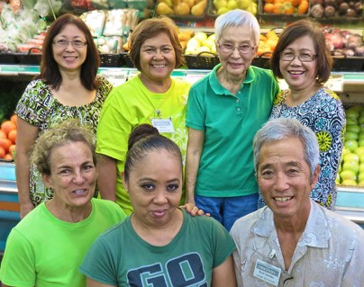 Some of Sueoka Store's longtime employees, back row, from left: Myra Kabazawa, Bernie Nunes, Betty Miyazaki, Naty Lorenzo. Front row, from left, Heidi Smyser, Patricia Locquiao, Rod Sueoka. Photo by Pamela Varma.