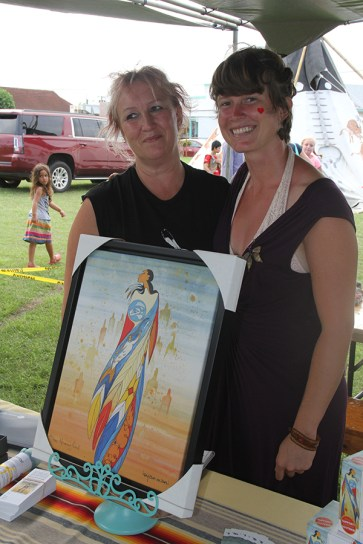 Heather Graham, of Canada, left, and J Bird, of Kapa'a