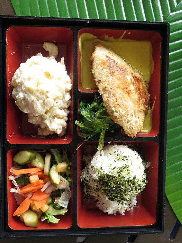 Mac Nut Crusted Ahi, an island favorite, is served bento style in a drinkable coconut lemongrass sauce. Namasu gets an upgrade with all the lightly pickled veggies, a crispy response to the sweet sauce.