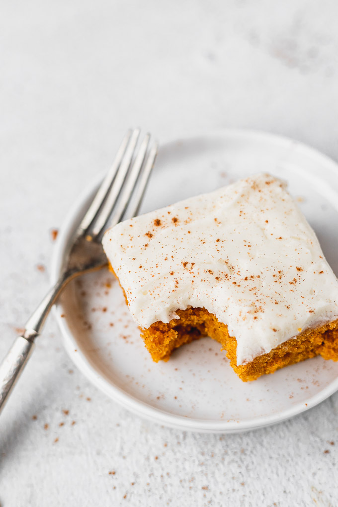 bite out of the best pumpkin bars with cream cheese frosting recipe