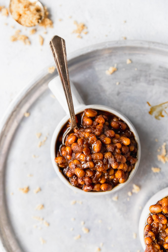 overhead baked beans in small bowl with spoon
