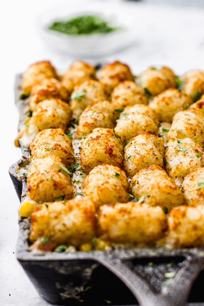 vegetarian tater tot hotdish in minnesota skillet up close by fork in the kitchen