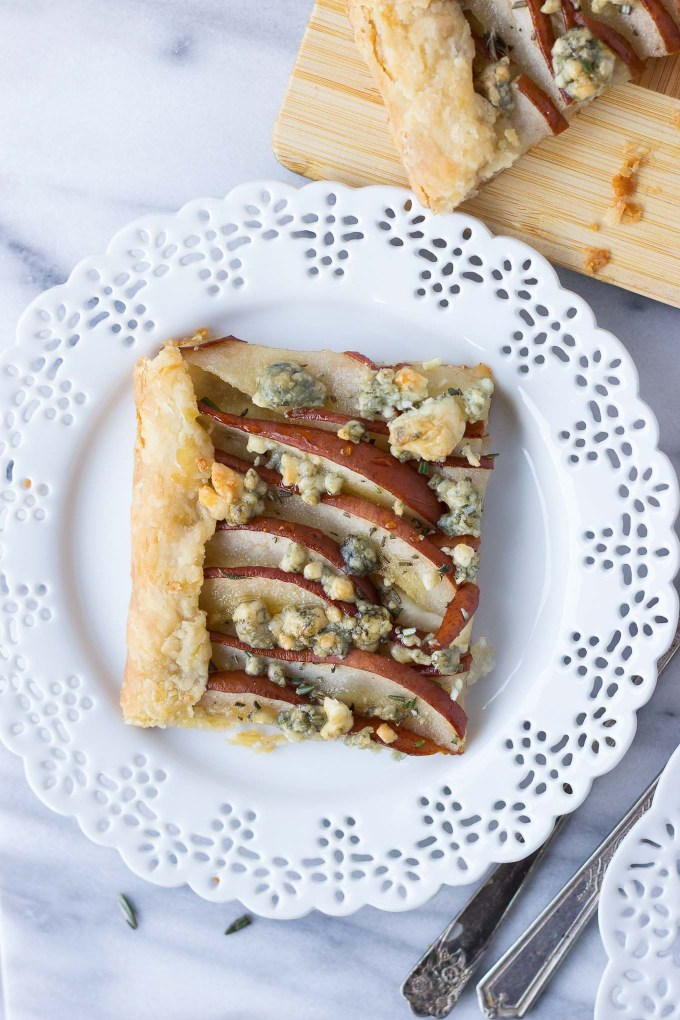 Savory Pear Tart - a flakey crust topped with Bosc pears, rosemary, gorgonzola, and drizzled with honey for the delicate balance of sweet and savory!
