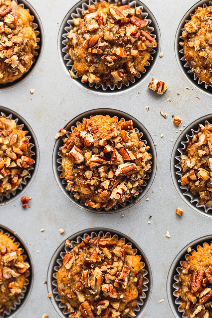 top down of baked banana carrot muffins in muffin tin