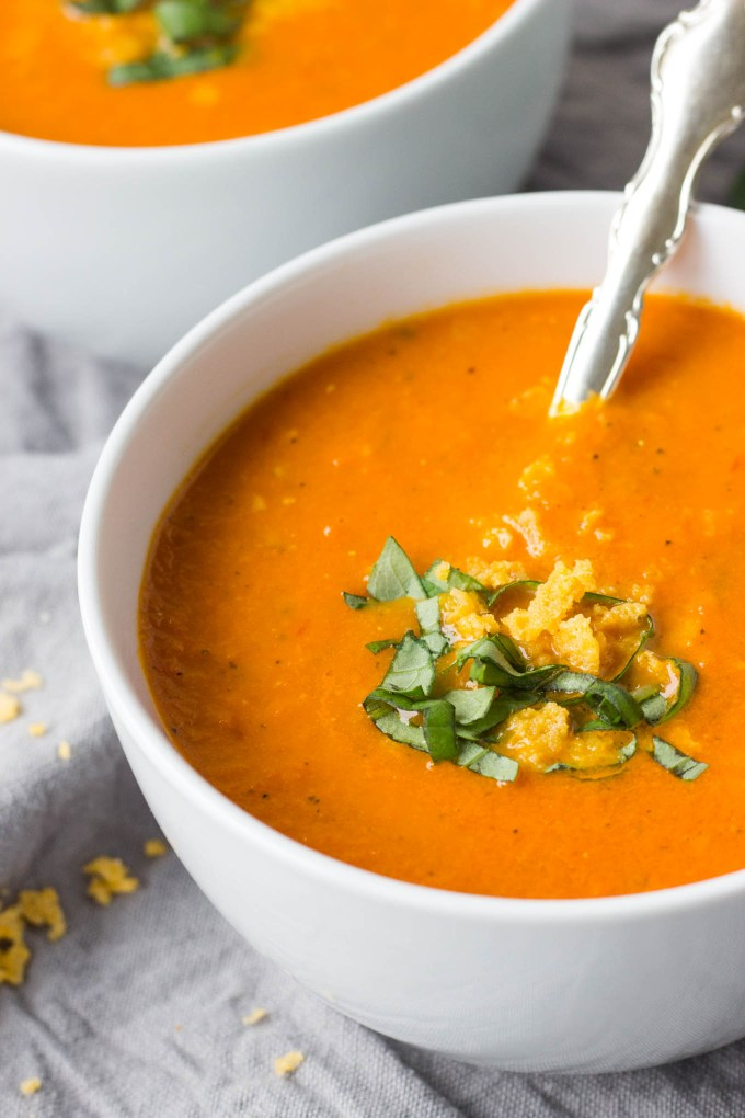 Roasted Tomato Carrot and Ginger Soup   A healthy, comforting soup full or rich flavor! It's gluten-free, dairy-free, and vegan! And goes perfectly with a crusty baguette.   Fork in the Kitchen