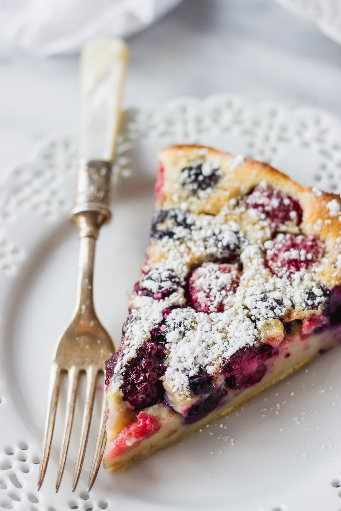 Triple Berry Clafoutis - An easy and elegant French dessert that's slightly sweet, made with your favorite summer fruits! | Fork in the Kitchen