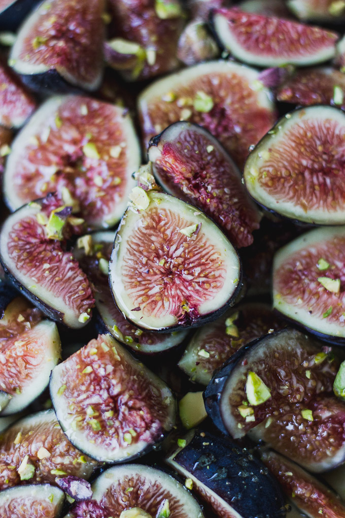 close up of figs with pistachios and honey