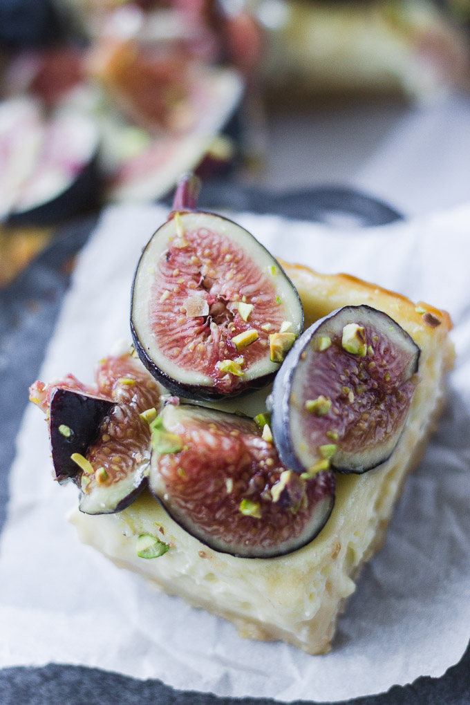 close up honey cheesecake bar with figs and pistachios