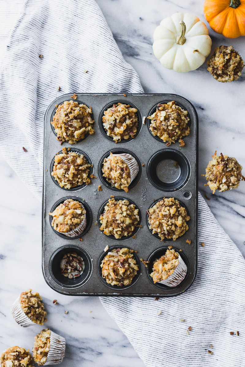 mini pumpkin coconut muffins in mini muffin tin by fork in the kitchen