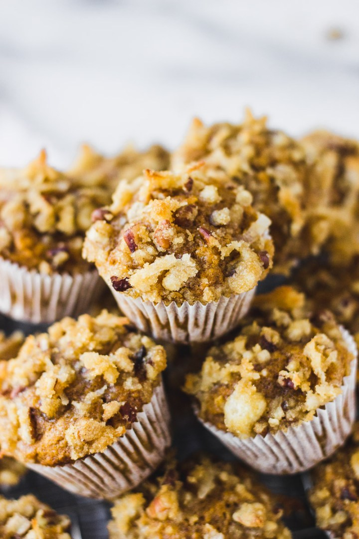 mini pumpkin coconut muffins in a pile by fork in the kitchen