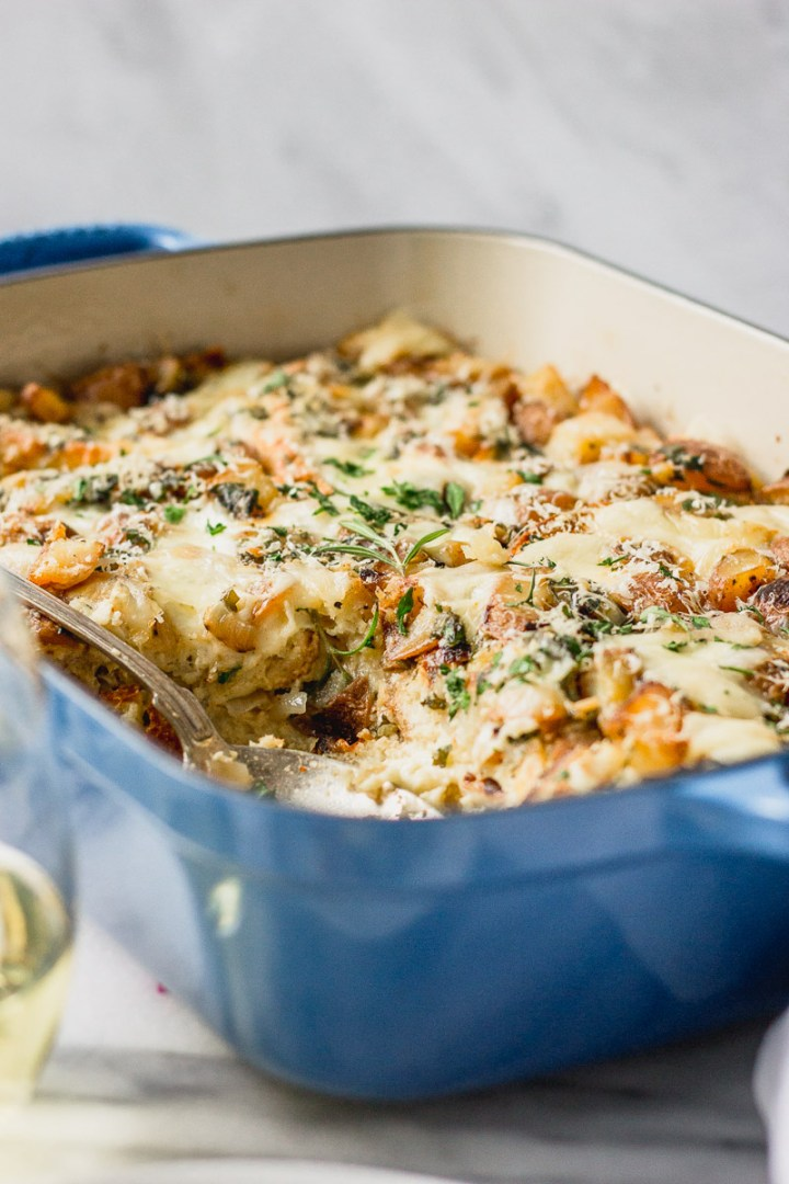 Winter Breakfast Strata with Fontina with spoon by Fork in the Kitchen
