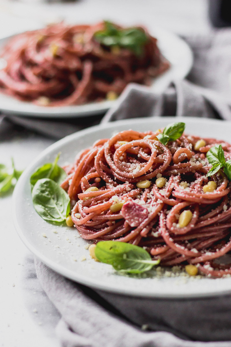 red wine spaghetti on plate by fork in the kitchen