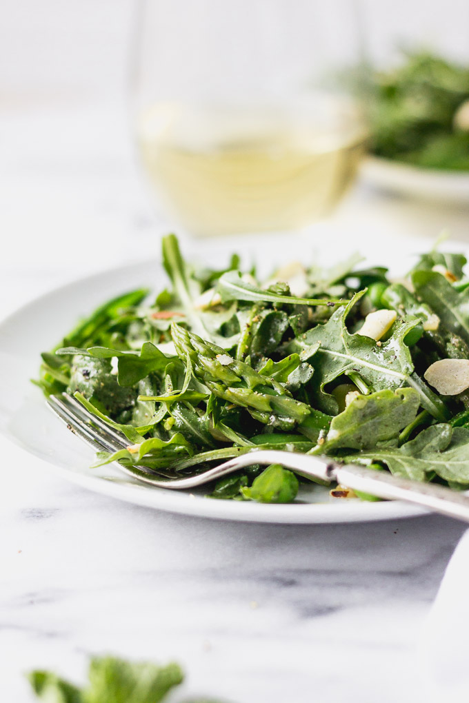 green vegetable salad with asparagus and peas in bowl