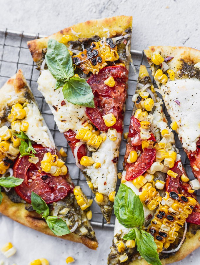 naan pizza recipe with burrata corn tomatoes and pesto