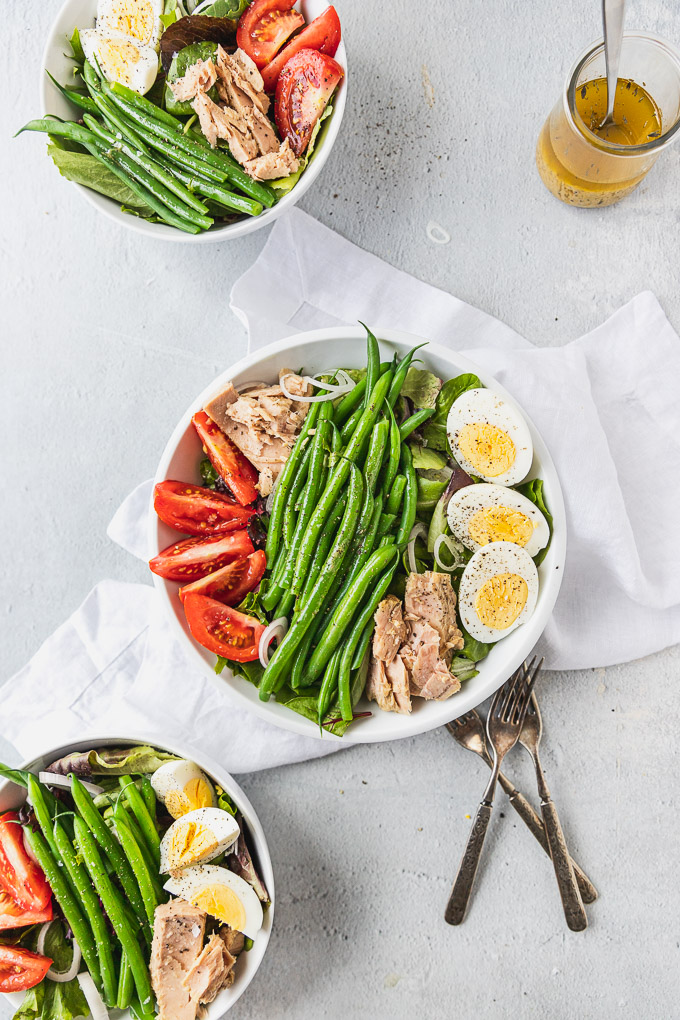 three nicoise salad bowls