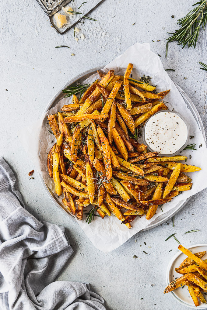 table with plate of crispy baked fries