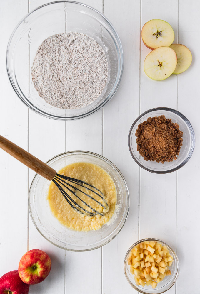 bowls of flour, wet ingredients, streusel topping, and apples