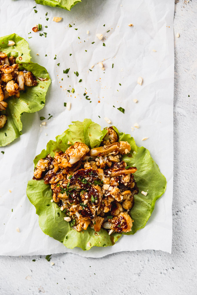 overhead cauliflower lettuce wrap on white background