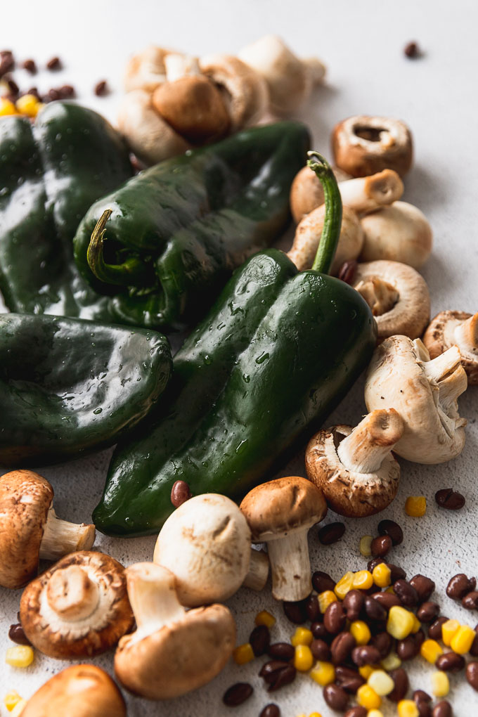 poblano peppers, mushrooms, corn, black beans on counter